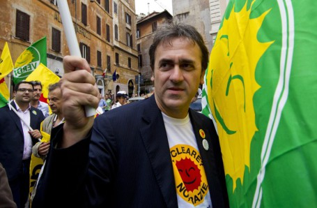 epa02778716 National president of Italy''s ecological party Verdi, Angelo Bonelli joins supporters in Pantheon Place, Rome 13 June 2011 following the result of the referendum on nuclear power. The inscription reads Thank You, Italy. although final results are expected later in the day, a majority of Italians appeared to have rejected the re-introduction of nuclear power in the country. EPA/MASSIMO PERCOSSI